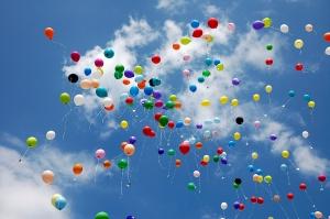 Sky full of coloured baloons