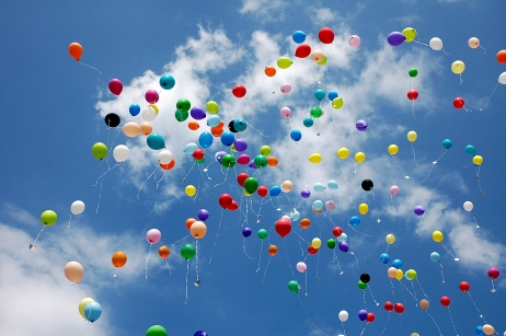 Sky full of coloured baloons