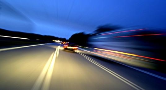 Blurred cars on road
